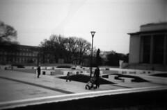 Holga 120FN - New Park in front of Janáček's Theatre (Kojotisko) Tags: street city people bw streets person holga czech streetphotography brno cc creativecommons czechrepublic streetphoto persons fomapan holga120fn