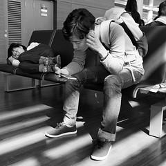 Waiting at Incheon airport (Harry -[ The Travel ]- Marmot) Tags: city travel people blackandwhite bw woman oktober man monochrome square airport october zwartwit capital reis korea photoblog stedelijk seoul southkorea stad incheon 2014 vierkant 500x500 monochroom schwarzweis hoofdstad travellogue 500500 reisverslag zuidkorea fotoverslag beeldverslag olympusomdem5 lumixgvario1235f28 nvbssne ©allrightsreservedcontactmebyflickrmail