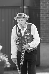 Musician (Jemma Graham) Tags: street blackandwhite bw musician playing town costume percussion yorkshire traditional hats entertainment whitby morris performers morrisdancers entertainers