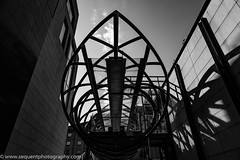 Out and About -13 (Philip Gillespie) Tags: black white mono monochrome shapes angles people buildings contrast sky clouds street photography photo sequent edinburgh scotland man sitting bridge shopping tourist shadow metal structure up shade sun walk walkway passage architecture building flyover dark light