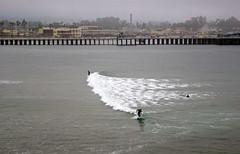 Surfing in the Fog (Schelvism) Tags: ocean california santa summer mist beach fog pacific cruz