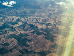(torrly) Tags: mountains west airplane landscape rockies coast power wind rocky aerial turbines