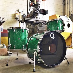 "Green glass glitter over mahogany shells. 22"", 13"", 16"". Photo op in the shop due to some light California rain. #qdrumco #mahogany #drums #atleastitsnotcold"