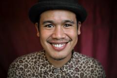 Krung Thep, the city of angels (fredcan) Tags: travel portrait man smile face hat closeup pose thailand asia southeastasia bangkok streetportrait thai youngman chatuchak krungthep thecityofangels fredcan