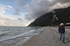 Walking on Portonovo beach (Lorenzo Canestrari) Tags: light italy nature water italia view panoramic vista marche paesaggio portonovo