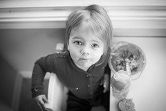 Amelia Eyes in Black and White (donnierayjones) Tags: red bw white black cup face closeup breakfast bread table kid eyes toddler child eating fork bowl oatmeal eat meal pjs pajamas