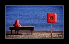 Woman on bench (tkimages2011) Tags: red blue water ireland northernireland bench woman cushendall antrim