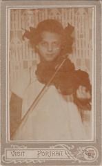 Art Nouveau portrait of a girl with a violin (c.1910) (pellethepoet) Tags: portrait girl child souvenir artnouveau photograph violin cdv cartedevisite mdchen violine visitportrait