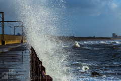Saltcoats storm (GenerationX) Tags: road blue sea sky white storm water lines clouds fence scotland rocks waves unitedkingdom january scottish neil spray foam promenade railings powerstation barr crashing ayrshire saltcoats