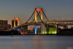 Rainbow at dusk.. (Shubhashish Chakrabarty) Tags: bridge winter japan tokyo rainbow dusk illumination 日本 東京 odaiba nightview nikkor 冬 rainbowbridge 色 レインボーブリッジrainbowbridge