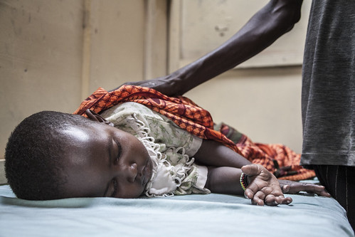 A mother and her sick child wait treatment in a hospital in Kakuma Refugee Camp, nortern Kenya.