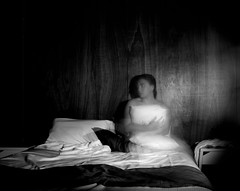 Sunday Nights (duck vs. chicken) Tags: longexposure blackandwhite selfportrait monochrome hotel blackwhite bed bedroom women sheets pillow youngwomen youngfemale