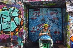 Is it the graffiti or the basker? (Marian Pollock - Thanks for a million+ views) Tags: street people graffiti australia melbourne lips drummer colourful cigarettes milkcrate hosierlane headgear basker