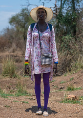 Young mursi tribe woman dressed in western clothes to go in town, Omo valley, Hana mursi, Ethiopia (Eric Lafforgue) Tags: africa portrait people color beautiful beauty face hat fashion vertical standing bag outdoors photography women day african culture blackpeople omovalley tall elegant ethiopia ethnic bizarre mursi cultural oneperson developingcountry elegance hornofafrica ethiopian eastafrica abyssinia realpeople lobe blackskin lookingatcamera fulllenght africanethnicity 1people ethnicgroup southethiopia fashionnable murzu magopark modernityandtradition hanamursi enlargedear ethio162268