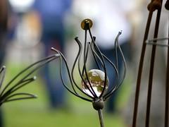 art in the garden (BrigitteE1) Tags: color colour art dof blossom steel crafts depthoffield handcrafted blte crystalball stahl glaskugel kunsthandwerk glasball artinthegarden kunstimgarten
