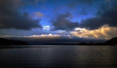 Upset.. (anek07) Tags: light cloud sun lake storm water clouds contrast dark hope contrasts sunbeams upset annaekman