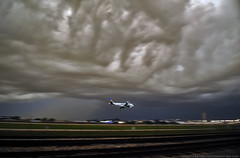 The Final Frontier (Infinity & Beyond Photography) Tags: sky storm weather clouds skies florida cloudy miami aircraft mia airbus airlines frontier airliner thunderstorms a319 kmia