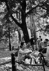 """She's got a way about her I don't know what it is"" - Billy Joel (explored) (Lidiya Nela) Tags: explore explored story blackandwhite bw urban greenwichvillage city canon manhattan newyorkcity newyork nyc streetphotography candid people park washingtonsquarepark"