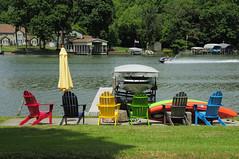 _DSC0947 (Chuck Eckert / Chicago & Beyond) Tags: river fox summer recreation leisure patio chairs umbrella furniture water shoreline shore jet ski boat house marine colored fun