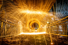 Steel Wool (Royal Hurlbert) Tags: longexposure urban wool night canon fire steel orb sphere spinning firespinning swirl sparks orbs fireball firespin spinfire steelwool paintingwithlights lightthenight wormholes photographyatnight canon7d lightjunkies spinwool steeljunkies steelwoolphotography lazyshutter lightpaighting