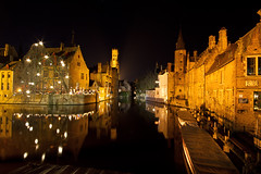 Rozenhoedkaai at night (smir_001 (on/off)) Tags: city winter light reflection tree tower tourism water architecture night buildings festive canal december belgium capital gothic brugge medieval belfry attractive historical bruges colourful flemish attraction dijver tallest westflanders rozenhoedkaai canoneos7d