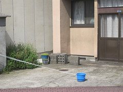 Reserving a car park - Iwakuni, Japan (Big Brisbane Boy) Tags: park blue house building car japan concrete japanese bucket iwakuni