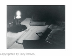 Reading by candlelight (Tony Roman Photography) Tags: things tonydarkroomanalogfilmprocess canon ae1p ilford 3200 candlight tonyroman tonyromanphotography copyrighted copyrightedbyanthonyproman eyecandyart anthonyproman photography