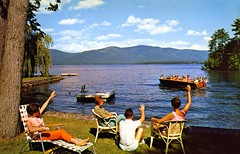 Monte Cristo Resort Diamond Point NY (Edge and corner wear) Tags: new york people lake ny mountains beach vintage boats hotel boat george wooden pc inn chairs postcard lawn shoreline motel lodge resort chrome raft motor float waving motorboat outboard