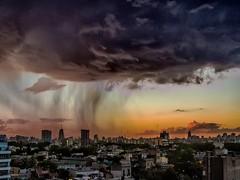 Lluvias al ocaso - Rain at sunset (celta4) Tags: city sunset argentina rain clouds buildings lluvia edificios buenosaires nubes ocaso ciuda