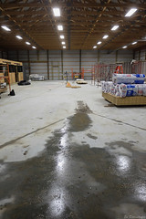 The concrete floor has been completed complete with floor drainage grates (ed dittenhoefer photo) Tags: barn construction tc3 coltivare farmtobistro