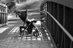 Baby On Bridge 0968 (casch52) Tags: bridge family summer portrait people bw baby white black male nature beautiful beauty face look female fun outdoors kid eyes chair day child carriage little head background small country watching young mother whitebottle