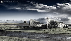 The Holy Island of Lindisfarne II - Boat Sheds (Silent Eagle  Photography) Tags: sep silent eagle photography canon island lindisfarne northeast clouds boats castle green shadows silenteagle09 bird reflection world100f ep9070 boatsheds northumberland holy woods the england uk north east silenteaglephotography copyright©