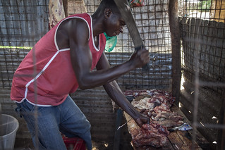 A butcher cuts the meat in Kakuma Refugee Camp, northern Kenya.