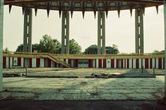 Crumbling Pavillion (george.bremer) Tags: park nyc summer film fairgrounds nikon decay flushingmeadows f3 worldsfair vuescan nystatepavillion adoxcolorimplosion
