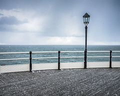 Expect Anything...It's Spring! (Fourteenfoottiger) Tags: ocean blue light sea sky snow storm beach weather clouds snowflakes coast pier worthing seaside spring may stormy calm lamppost blizzard britishspring