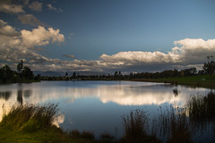 Boit (Nick Pemberton) Tags: blue trees light sky panorama lake reflection green water grass clouds canon reeds landscape mirror parks calm explore filter tamron amateur waterway discover d700