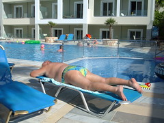 Snoozing by the Mythos pool (pj's memories) Tags: pool kos slip trunks sunbathing speedos sunlounger tingaki tanthru mythosaparthotel