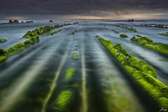 calm in the storm (Javy Njera) Tags: sunset sea naturaleza verde green beach nature water rock clouds atardecer mar sand agua natural tide wave playa arena nubes vizcaya roca ola marea barrika