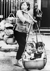 A Vietnamese woman carries her children and possessions on bamboo pole as she tries to escape fierce fighting in the Cholon suburb of Saigon during the Viet Cong Mini Tet offensive of the Vietnam War in May 1968. [700 x 994] #HistoryPorn #history #retro h (Histolines) Tags: she woman history children during war vietnamese escape fierce may mini x bamboo her retro pole vietnam viet timeline tries suburb 1968 tet fighting 700 offensive saigon possessions carries cholon cong 994 vinatage a historyporn histolines httpifttt1q0h9a2