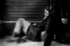 Passer By (Howard Sandford) Tags: blackandwhite bw monochrome sleep homeless streetphotography doorway passerby bnw helpless ignored sleepingrough