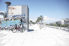 Sneaking up (df-stop.) Tags: urban paok thessaloniki greece graffiti walkway sky bicycle van summer day corner angles perspective chimneys concrete architecture city nopeople buildings dfstop canon trees cloud hideandseek distance parked blue light macedoniagreece macedonian makedonia timeless