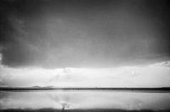 Natures Rothko (spannerino) Tags: ocean light newzealand blackandwhite seascape blur film monochrome contrast analog 35mm pentax outdoor horizon grain wideangle auckland 35mmfilm scanned rothko pointandshoot analogue vignette expiredfilm handprocessed filmlives ilfordlc29 pentaxespiomini canon9000f