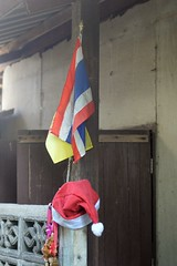 country, king, and santa claus (the foreign photographer - ) Tags: jul172016nikon national kings flag santa cap dried garland country khlong thanon bangkhen bangkok thailand nikon d3200