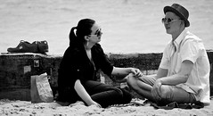 BeachChat (Hodd1350) Tags: bournemouth boscombe dorset hat shoes couple bw wb blackwhite whiteblack sea shore sand shades sunglasses talking crosslegged olympus zuikolens penf groyne paperbag