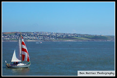 Sailing on the Ocean (benharries366) Tags: photography photo collegeassignment collegework flat calm buildings houses house water sky sail ruleofthirds rulesofthirds blue ogmorebysea ogmore sailingboat boat sailing ocean sea seafront porthcawlseafront porthcawlpier southwales bridgend porthcawl