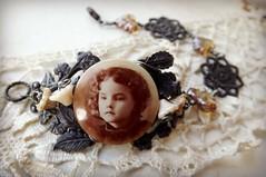 Sweet little girl of long ago (lilruby) Tags: lilrubyhandcraftedjewelry bracelet filigree vintagepicturebutton memoryjewelry bsueboutiquescomponents ancestor sepiatone