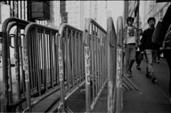 latest angles - nypd fencing (Mattron) Tags: nyc newyorkcity newyork slr film analog kodak manhattan broadway streetphotography nypd d76 midtown sidewalk pentaxk1000 tmax400 nofilter barricade theaterdistrict