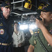 USS Sampson conducting helicopter search-and-recovery operations over the Java Sea