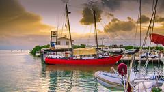 The Red Sailboat (Denzil D) Tags: sunset water sailboat boats restaurant florida floridakeys loveboat greenwater romanticsunset wifescamera canonpowershots95 womanshome