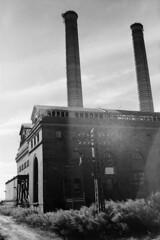 Yonkers Power Station (colinpoe) Tags: blackandwhite bw silhouette mediumformat ruins glenwood smokestack lensflare powerplant yonkers powerstation redfilter sunflare 620 six20 medalist kodakmedalistii industrialruin industrialarchitecture yonkerspowerstation glenwoodpowerplant medalistii kodakmedalist industrialstacks nychrpowerplant